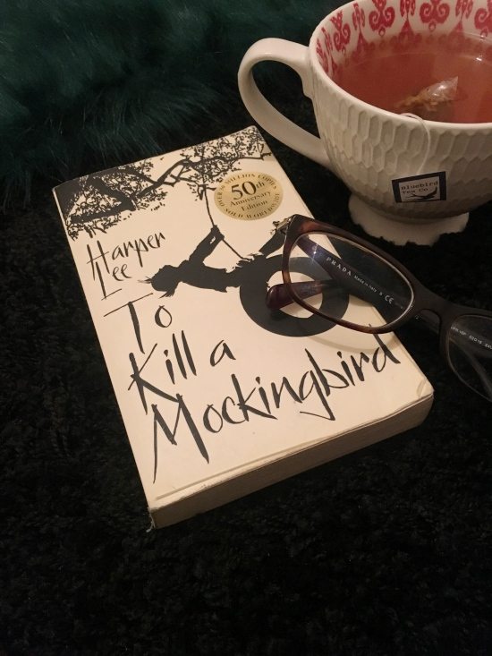 50th Anniverary paperback edition of To Kill a Mockingbird with cup of tea from Bluebird Tea Co.