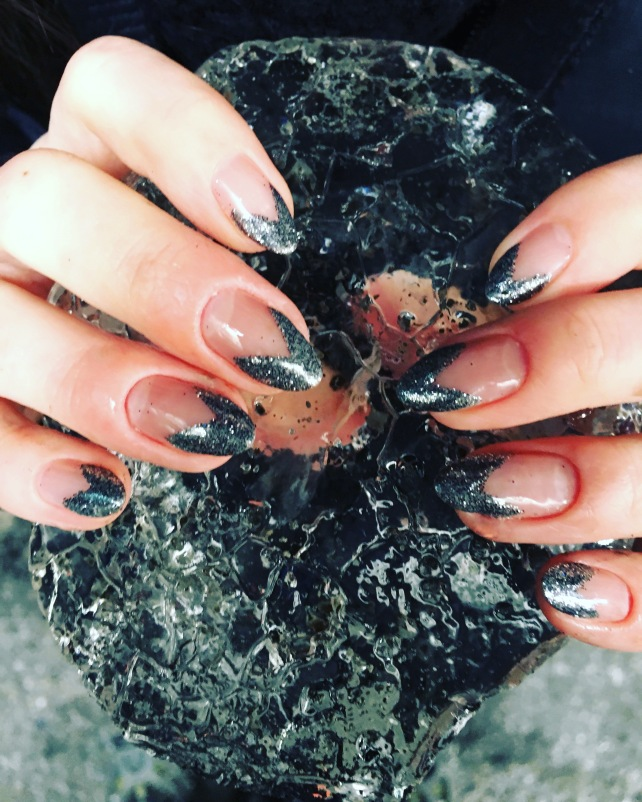 Silver Glitter Chevron Nails holding glacial ice from Icelandic ice cave. Nails by Naf Salon, Glasgow.