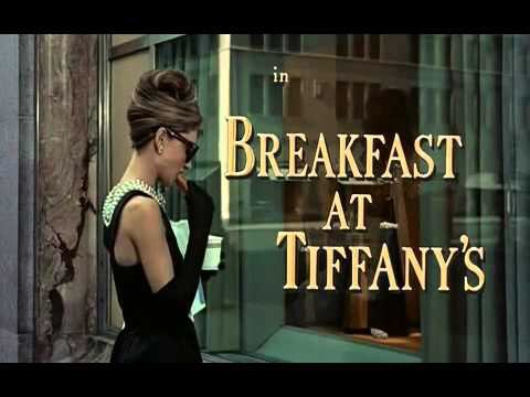 Opening Credits for Breakfast's at Tiffany's. Audrey Hepburn in pearls eating a pastry at Tiffany's 5th Avenue.